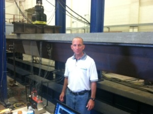Dr. Karl Barth conducts a test on the new shallow steel press-brake tub girder technology.